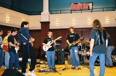 pic17doing a clinic with l.a.x. at teen guitar and base workshop